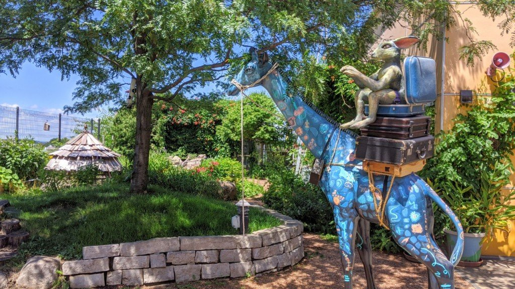 The Madison Children's Museum's rooftop Garden, with its large blue giraffe statue.