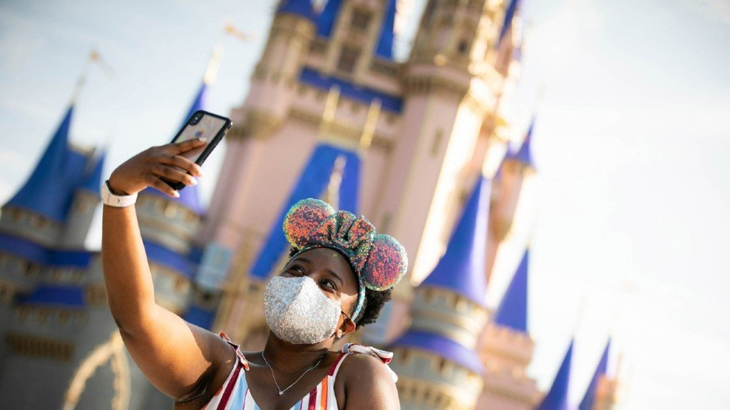 a Walt Disney World guest stopping to take a selfie at Magic Kingdom Park on July 11, 2020