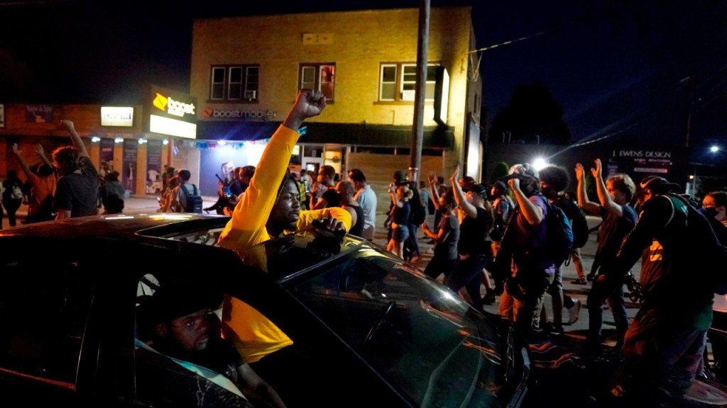 A Motorist Raises His Fist In Solidarity With A March Protesting The Police Shooting Of Jacob Blake In Kenosha Viacnn 1280