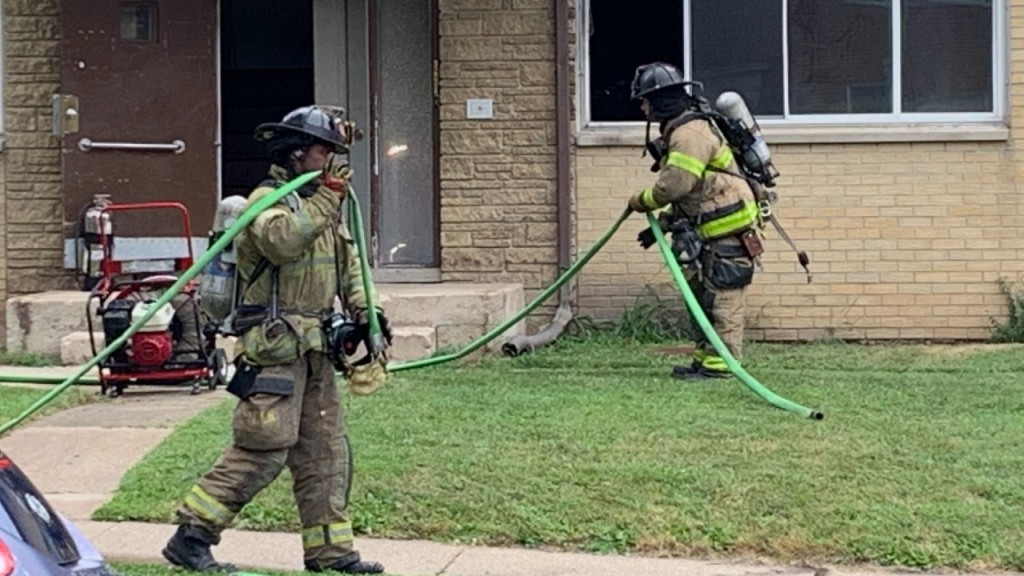Firefighters outside apartment building
