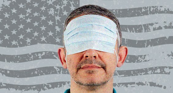man wearing a mask over his eyes with a gray flag in the background