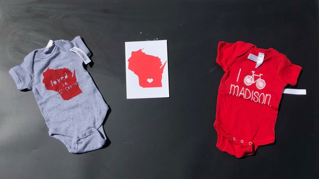 two onesies with Wisconsin theme and a card