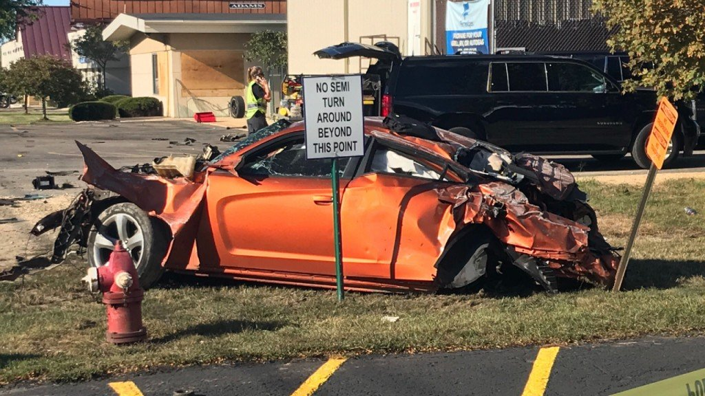 A damaged vehicle involved in a fatal Stoughton Road crash
