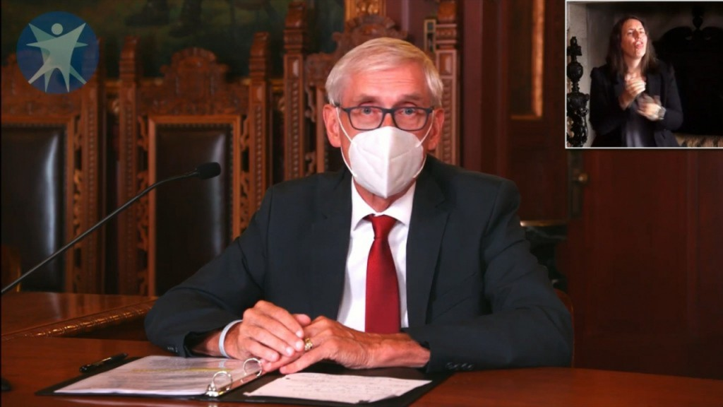 Evers wearing a mask