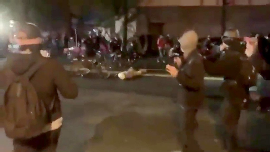 Seattle police officer riding his bike over a protester's head