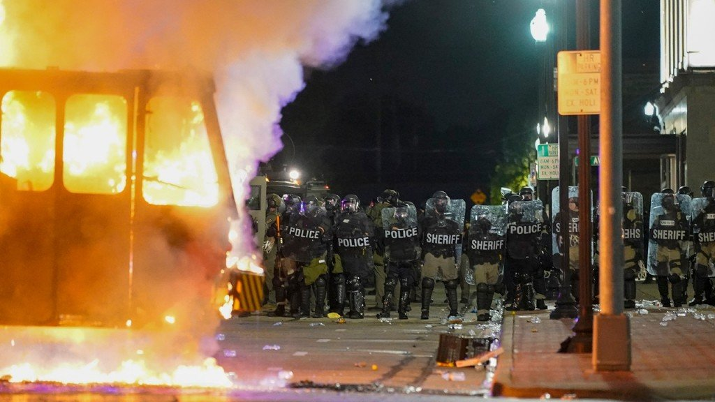Police Stand Near A Garbage Truck Ablaze During Protests, Monday, Aug. 24, 2020, In Kenosha
