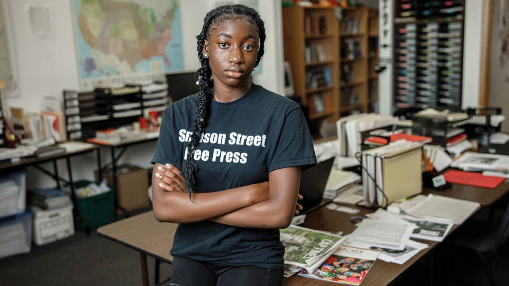 Yani Thoranka in a classroom with a Simpson Street Free Press Shirt