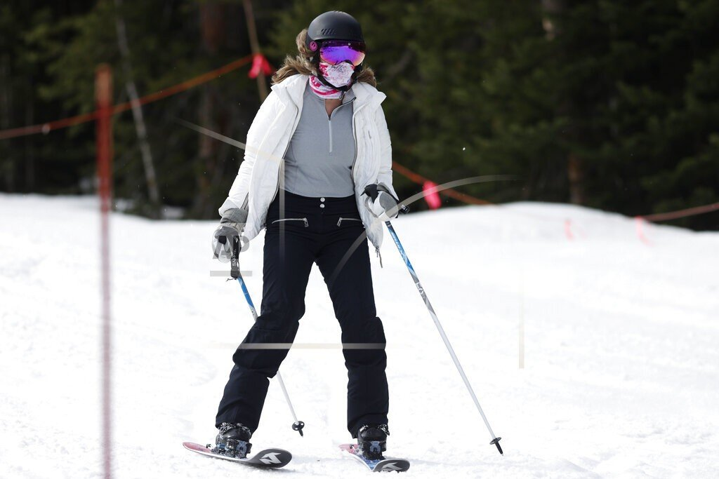 In this May 27, 2020, file photo, a skier wears a face covering while negotiating the slope at the reopening of Arapahoe Basin Ski Resort, which closed in mid-March to help in the effort to stop the spread of the new coronavirus, in Keystone, Colo.