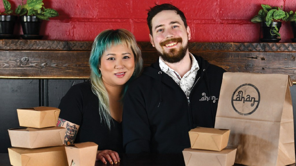 Jamie Hoang and Chuckie Brown Sitting next to takeout boxes