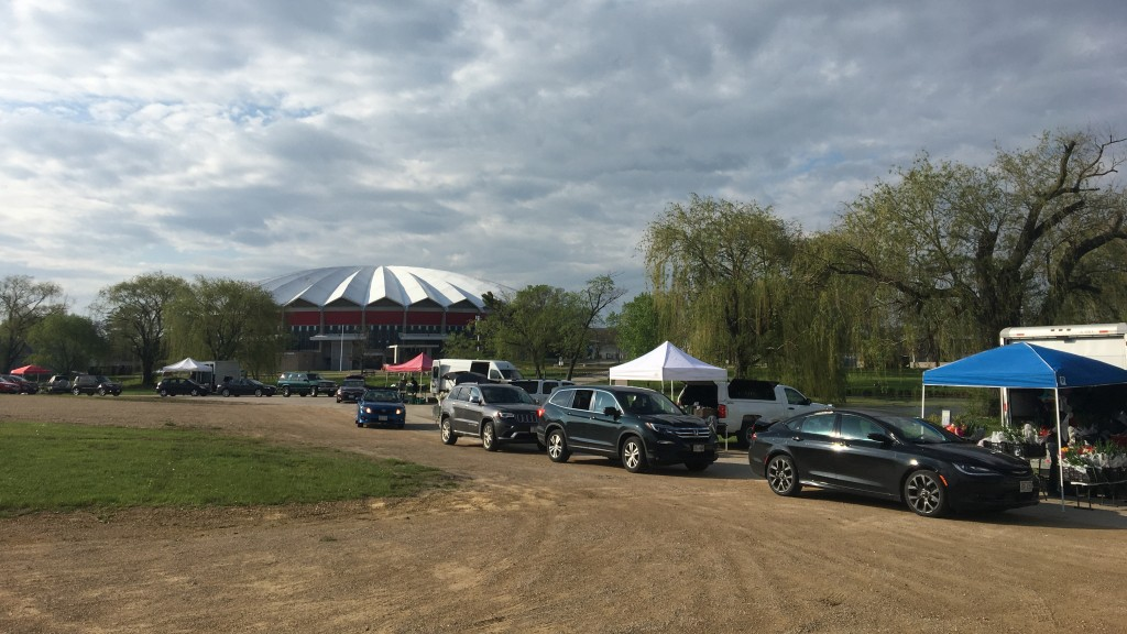 Patrons Drive Through The Dcfm Local Food Pick Up On Willow Island At The Alliant Energy Center.