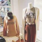 sweatshirt on a maniquin and a skirt with a shirt that says Be Kind