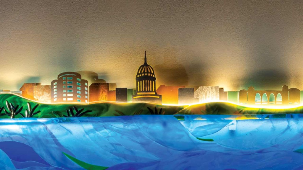 glass art piece with Madison skyline