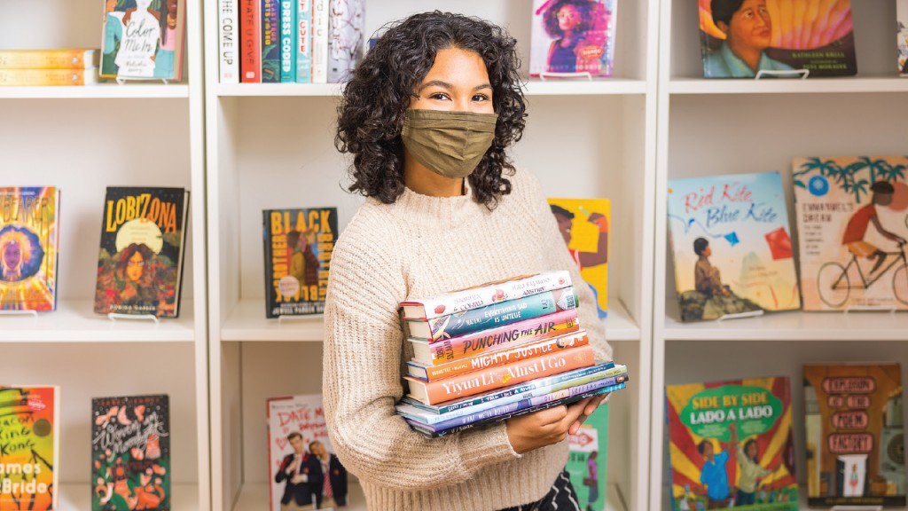 Dominique Lenaye standing in book shelves
