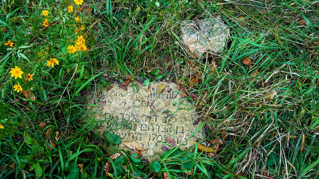 stone grave marker at Natural Path Sanctuary