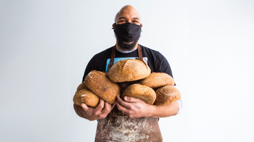 Mo Cheeks holding bread