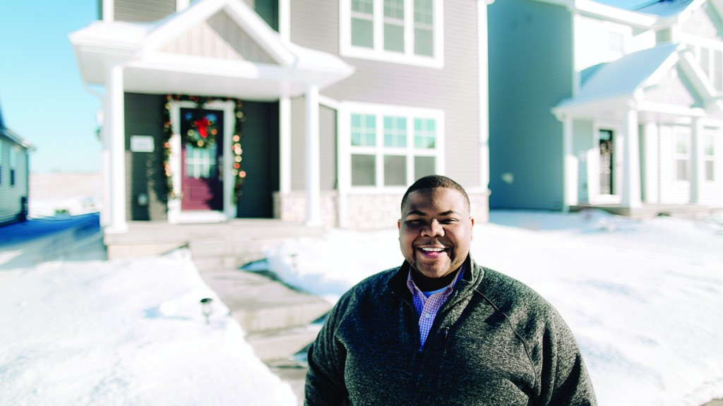 Chris Reece in front of his new home