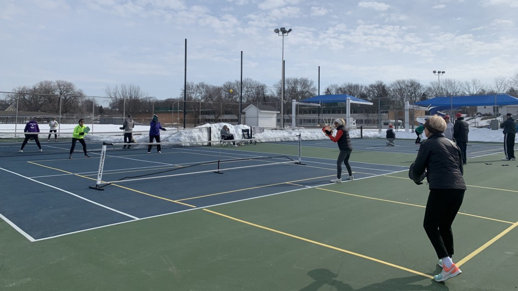 Senior citizens get together to play pickle-ball