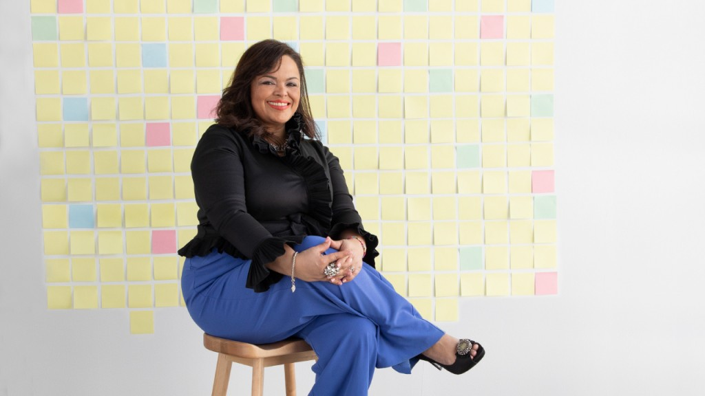 Jessica Cavazos in front of a wall of stickie notes