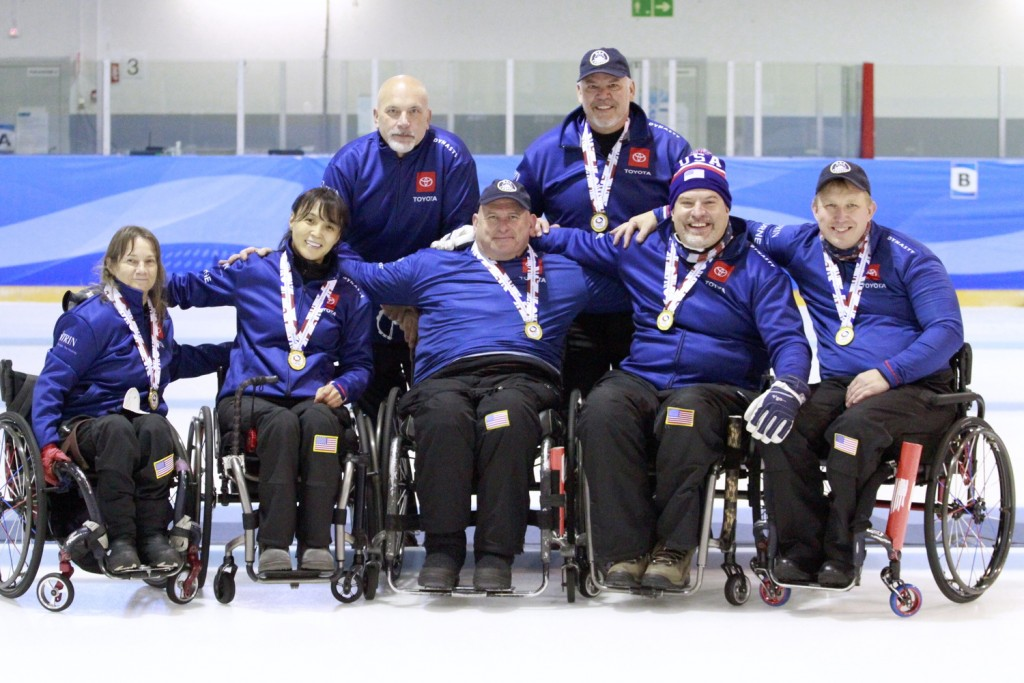 US wheelchair curling team poses on ice