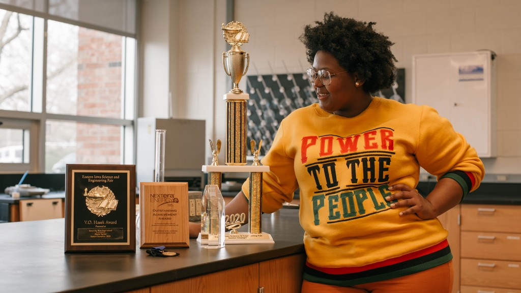 Dasia Taylor poses with her awards