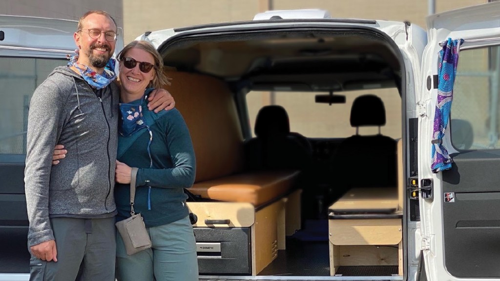Melody and craig in front of their camper van