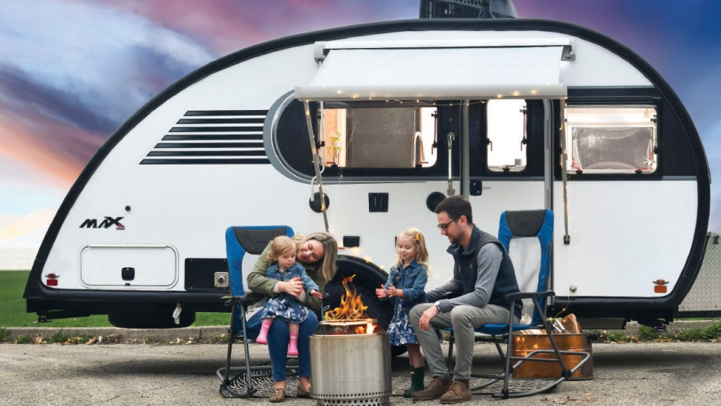 Berry Family sitting in front of their teardrop trailer
