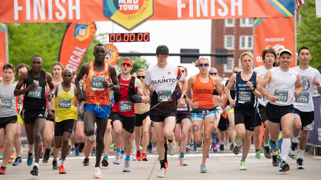 Runners take off at a race start.