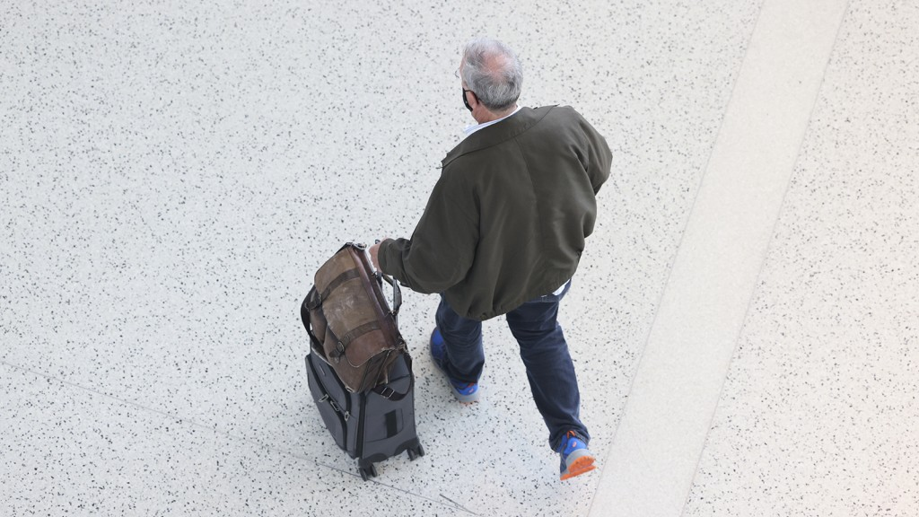 Man walks with suitcase