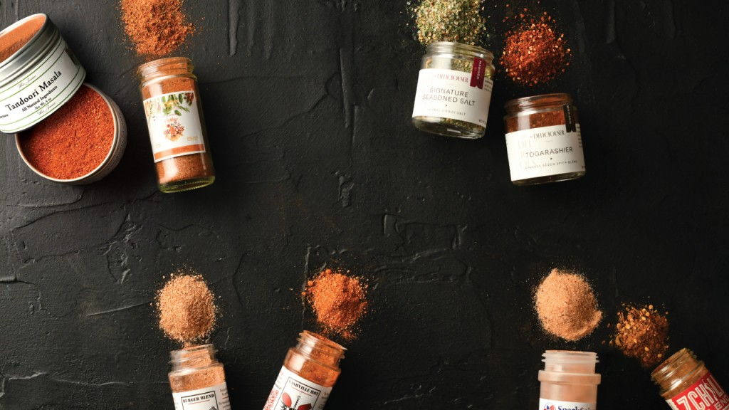 All of the spices against a black backdrop