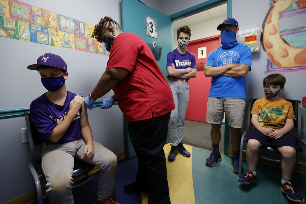 Family Members Look On As Jack Frilingos, 12, Is Inoculated With Pfizer's Vaccine Against Coronavirus Disease (covid 19) After Georgia Authorized The Vaccine For Ages Over 12 Years, At Dekalb Pediatric Center In Decatur