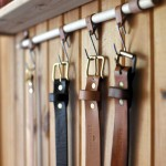 belts hanging on a wall