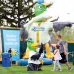 kids high-fiving the Maynard and in front of inflated ducks