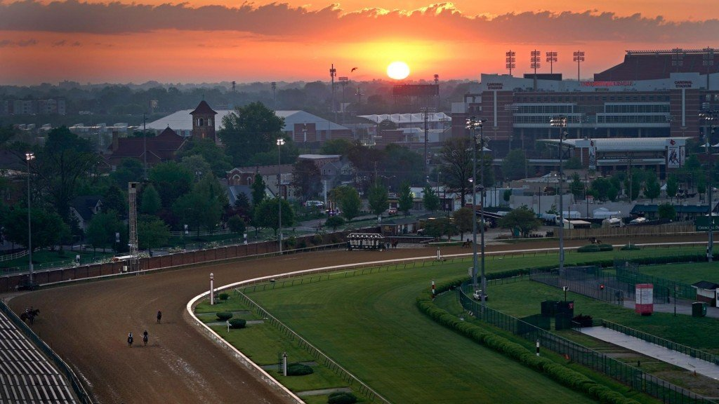 Horses work out as the sun rises at Churchill Downs