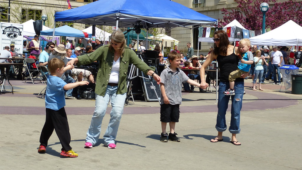 People dance to live music at a WORT Radio block party in Madison, Wisconsin.