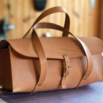 tan leather bag on a work station