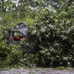 Wind, Rain Pound South Amid Flood Fears And Water Rescues