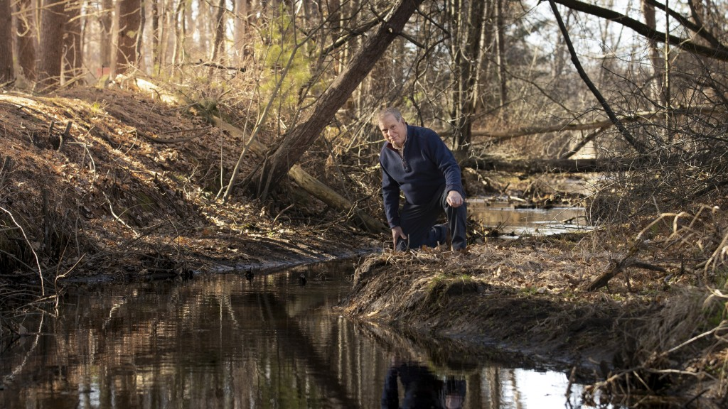 Jeff Lamont, a Marinette, Wis., resident and retired hydrologist, is seen next to a creek where it empties into Lake MichiganÕs Green Bay. This creek is the most highly PFAS-contaminated of all the tributaries that empty into the lake based on a recent study funded by The Sea Grant Institute. Sampling occurred at all significant tributaries from the eastern shores of Green Bay at the north end of Door County, Wis., to Escanaba, Mich.
