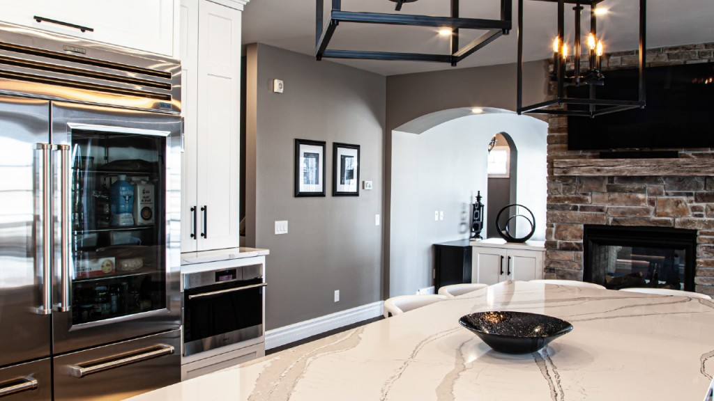 Interior of white cabinets and marble countertop kitchen