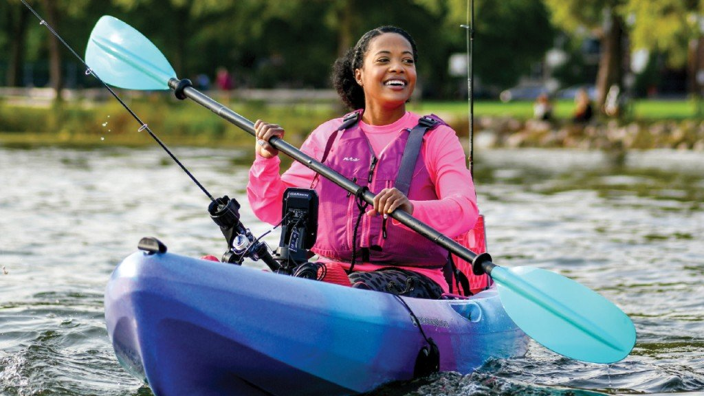 Ashley anderson smiling on her kayak