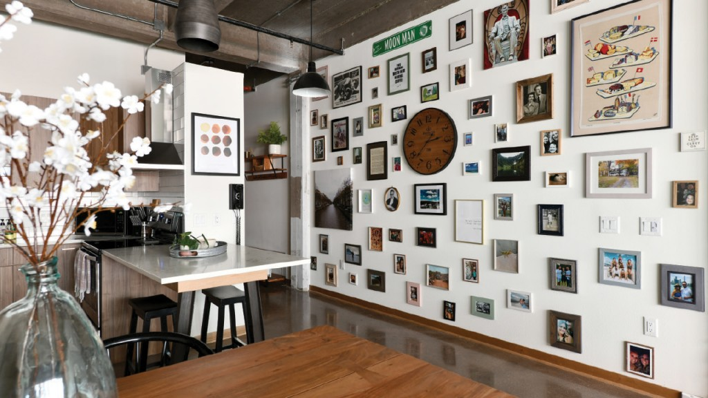 Loft living room wall filled with mementos and photographs