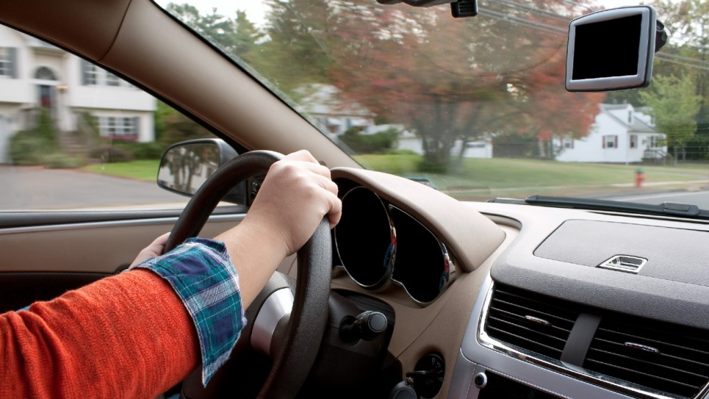 A Woman Holds The Steering Wheel Of A Car While Driving Down The Road Htdurkrbo 1