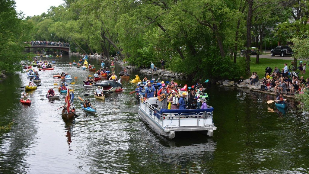 Members of the River Rats band play from an MSCR pontoon boat during the 2019 Fool's Flotilla.