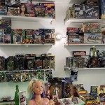 rows of shelving above the checkout table with rarer collectibles