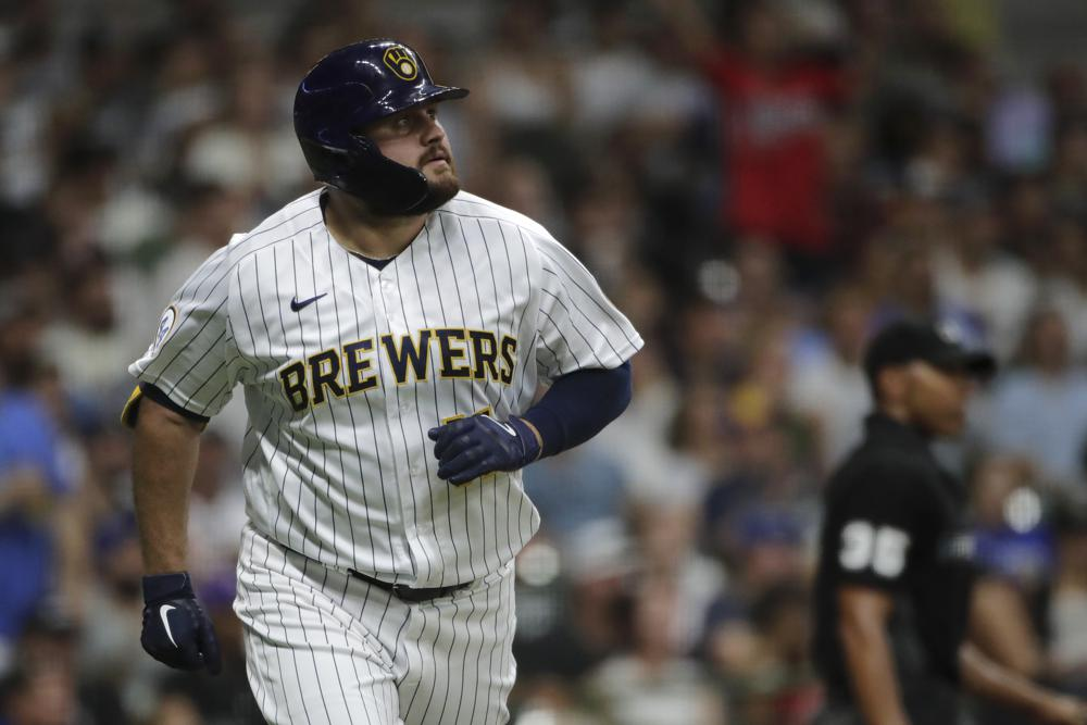 Milwaukee Brewers' Rowdy Tellez watches his solo home run during the sixth inning of a baseball game against the Chicago White Sox, Saturday, July 24, 2021, in Milwaukee. (AP Photo/Aaron Gash)