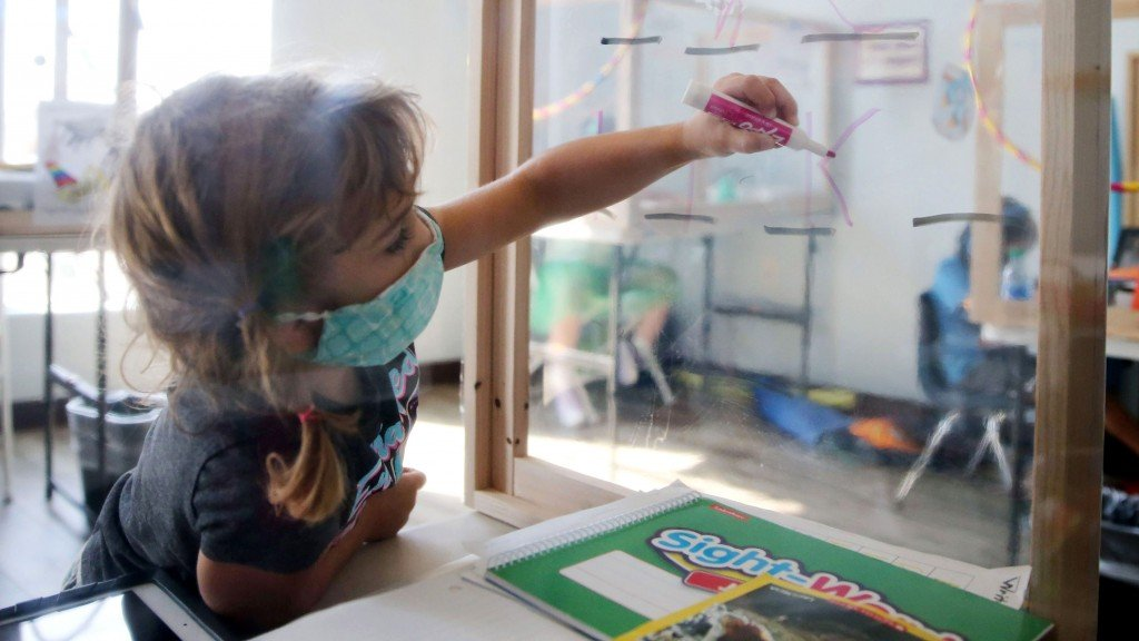 California School Kids Attend School Remotely Within Small Learning Groups At Enrichment Centers