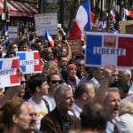 The Latest: French Police, Protesters Clash Over Virus Pass