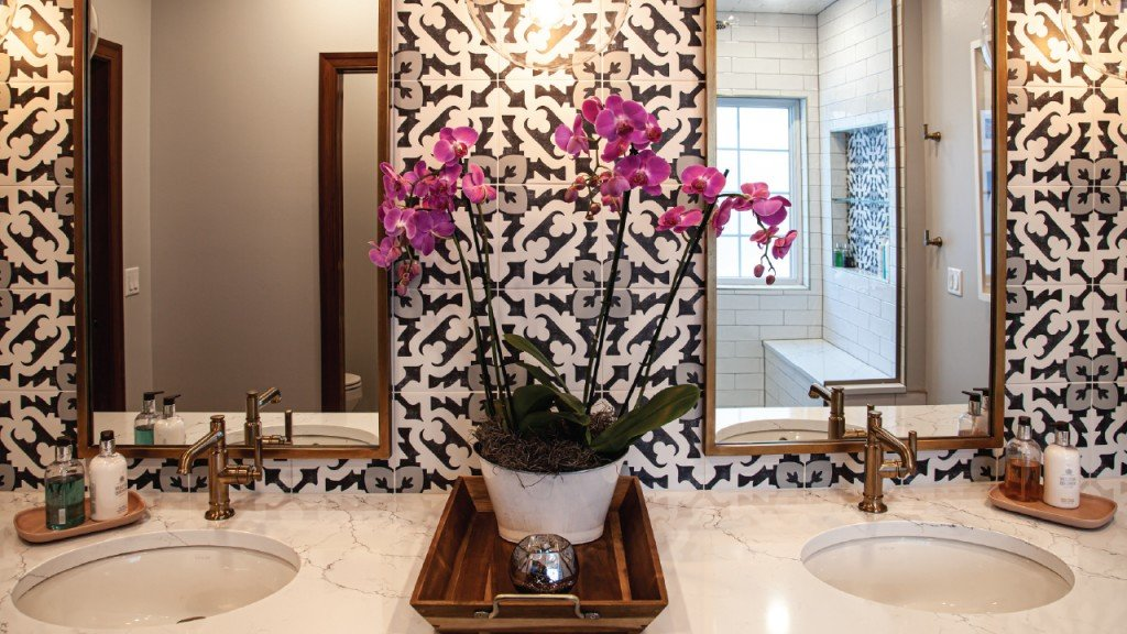 Double Sink and mirrors in tiled bathroom