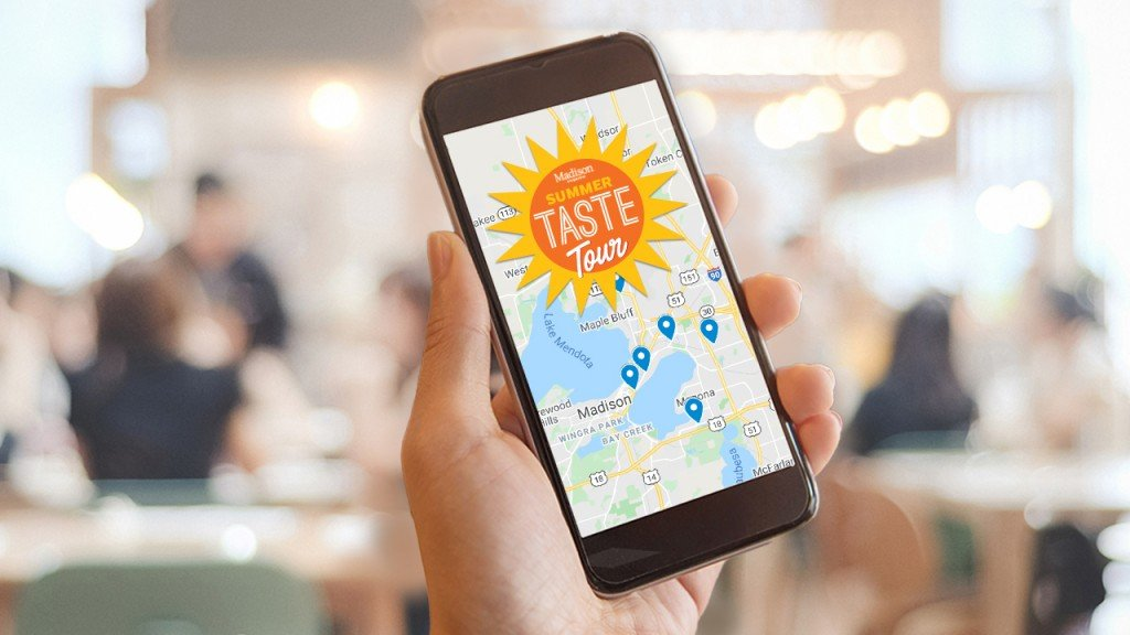 person holding a phone with the summer taste tour logo