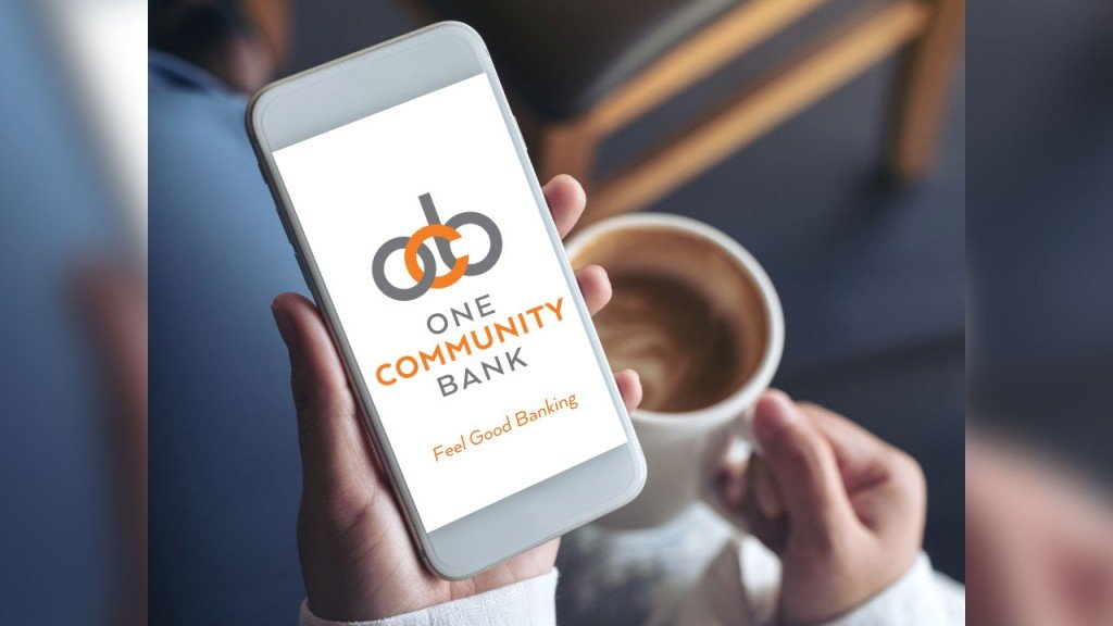 person holding phone with One Community Bank app