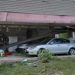Part of a Jefferson County home collapses on a vehicle in the garage